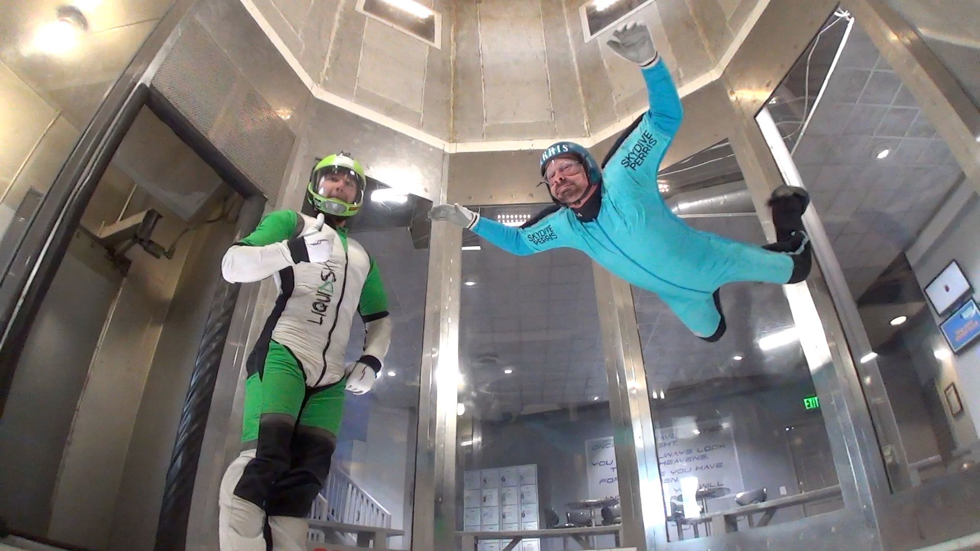 man in blue jumpsuit tries indoor skydiving at Perris, CA