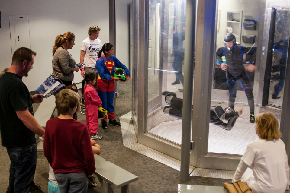 people watch experienced flyers in our skydiving simulator