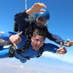 One skydiver jumps while wearing goggles.