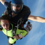 tandem skydiving safely harnessed to instructor
