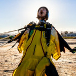 Wakita Nozomu celebrates after landing his first wingsuit jump