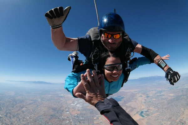 skydivers celebrates first jump in freefall with high five