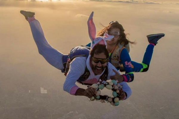 man in freefall as Easter bunny for skydiving boogie