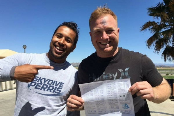 man holds up skydiving license at Perris