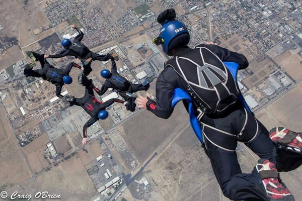 formation skydiving team jumps at Perris