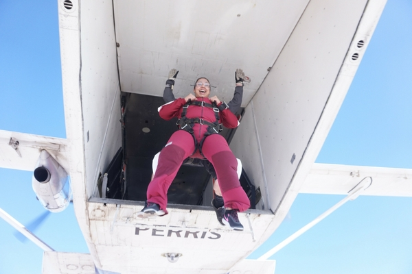 tandem skydiving student jumps out of plane