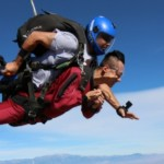 tandem skydiving instructor about to deploy parachute