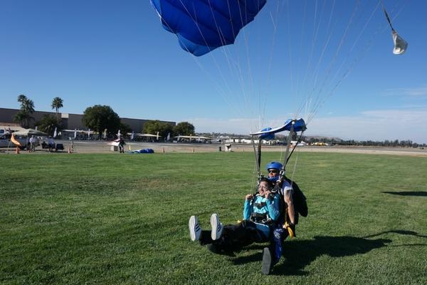 skydiving landing under parachute