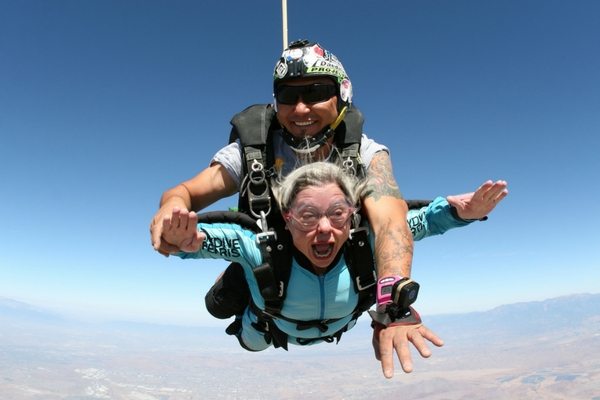 older woman in skydiving freefall for the first time