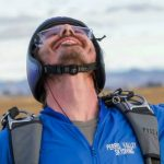 licensed skydiver looks up to the sky
