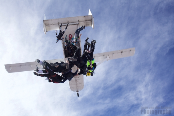 experienced skydivers exit plane at Perris