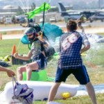 experienced skydiver gets squirted with water guns upon landing