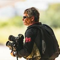 Craig O'Brien with camera and skydiving rig