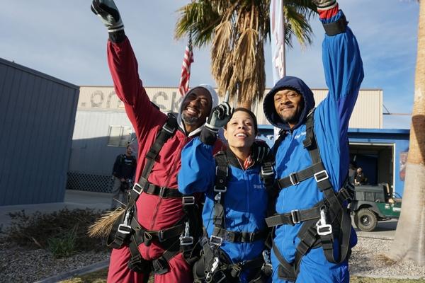 friends celebrate making a skydive at Perris