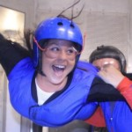 woman indoor skydiving first time in tunnel