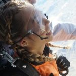 young girl finds a reason to skydive out of an airplane