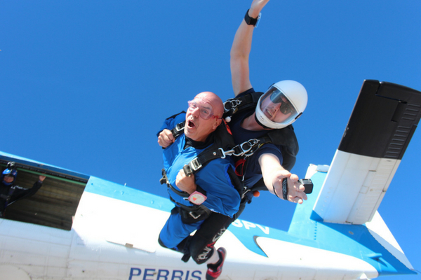 man faces fear of skydiving and exits plane