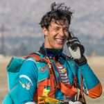 experienced jumper smiles after landing from skydive