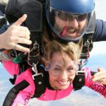 woman in pink jumpsuit has life-changing skydiving experience