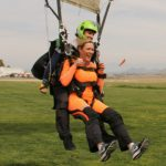 woman smiles as she lands from first tandem skydive