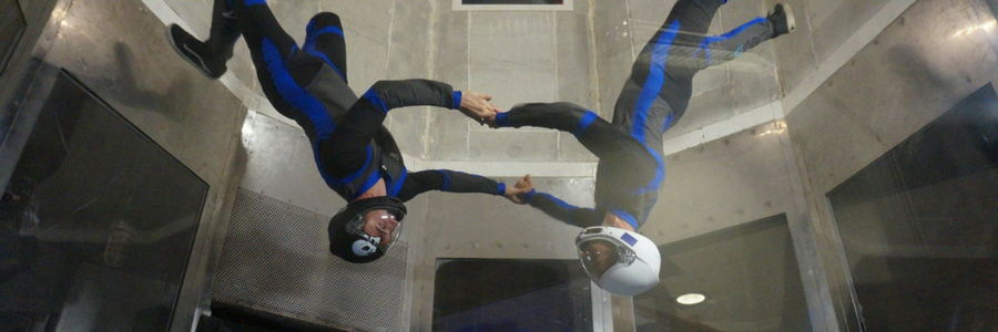 two men fly upside in Perris wind tunnel