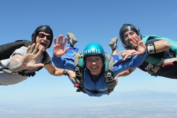 female aff skydiving student in freefall with 2 instructors