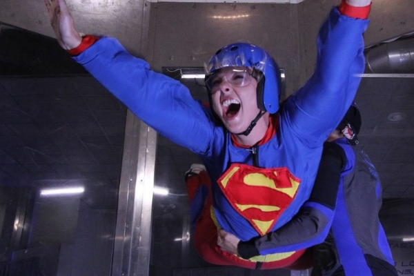 young woman having tons of fun indoor skydiving