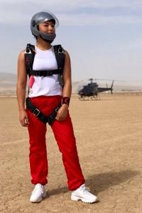 deb brown standing in skydiving rig