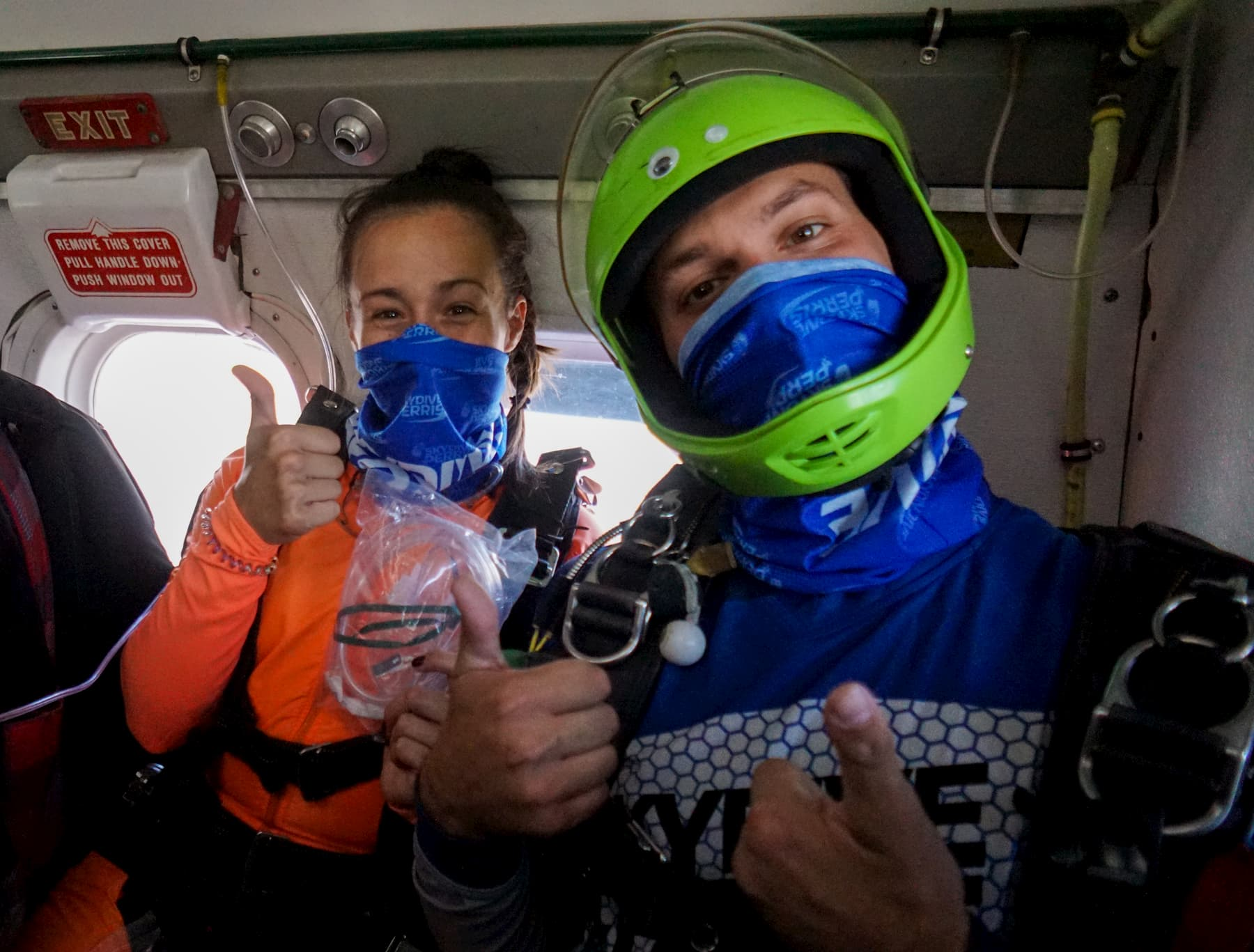 Two skydivers prepare for a jump.